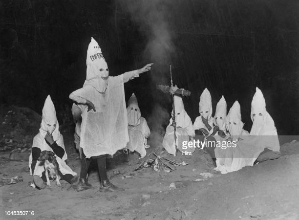A group of children mimicking the regalia and activities of the Ku Klux Klan East Lots Canarsie Brooklyn New York City circa 1925 Calling themselves...