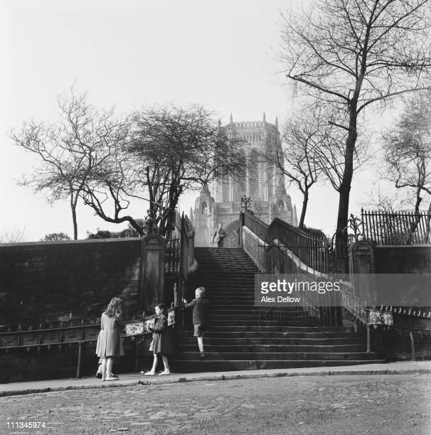 A group of children near the steps to Liverpool Anglican Cathedral on St James's Mount Liverpool June 1955 Original publication Picture Post 7795...