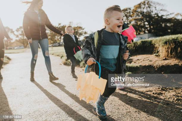 group of children on a day trip - focus on delighted little boy - child stock pictures, royalty-free photos & images