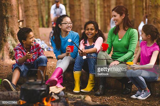 group of children on a field trip - girl scout stock pictures, royalty-free photos & images