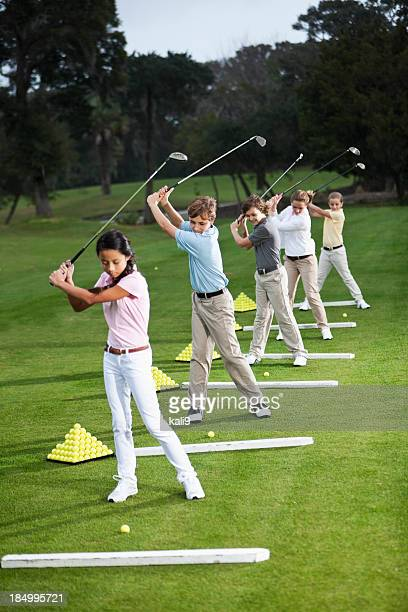 Group of children on golf driving range