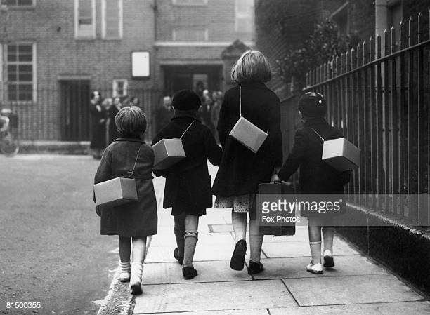 A group of children on their way to school in west London fully equipped for an evacuation rehearsal 28th August 1939