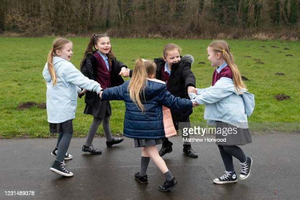 Group of children play outdoors at Glan-Yr-Afon primary school on March 3, 2021 in Cardiff, Wales. Children aged three to seven began a phased return...