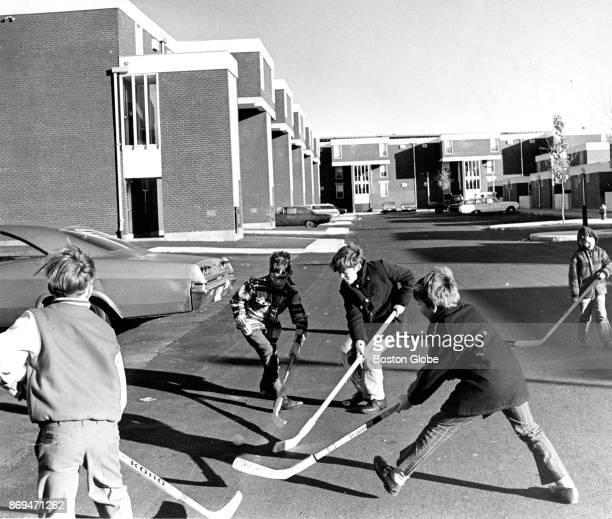 A group of children play street hockey outside of homes on Medford Street in the Charlestown neighborhood of Boston on Nov 19 1971