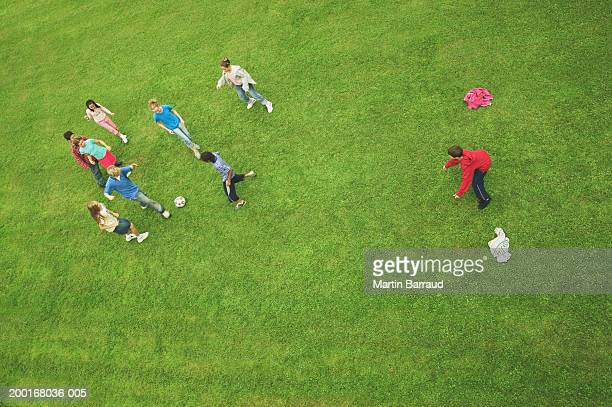 group of children (9-12) playing football, elevated view - ゴールポスト ストックフォトと画像