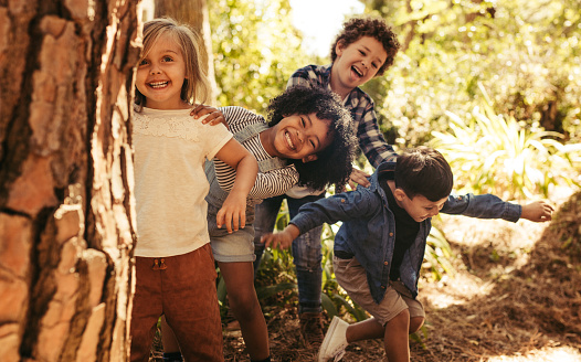 Group of children playing hide and seek 1145906943
