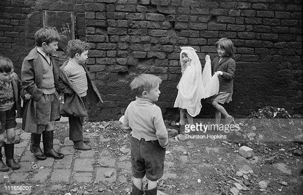 A group of children playing in a slum area of Liverpool 19th November 1956 One of the girls is wearing a wedding headdress Original publication...