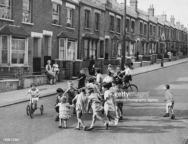 A group of children playing in a street in Willesden northwest London circa 1950