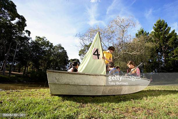 Group of children (9-13) playing in boat
