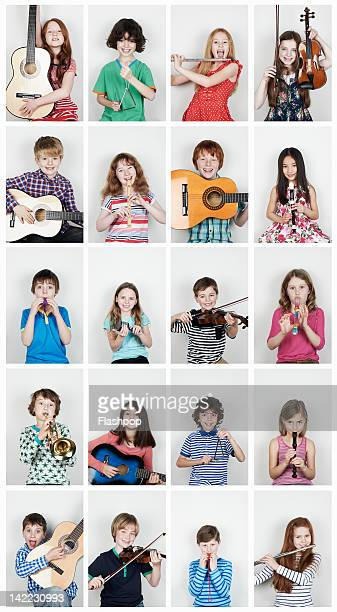 group of children  playing musical instruments - triangle percussion instrument stock photos and pictures