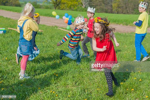 Group of children playing on a meadow