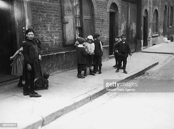 A group of children playing on a street in Whitechapel East London August 1911