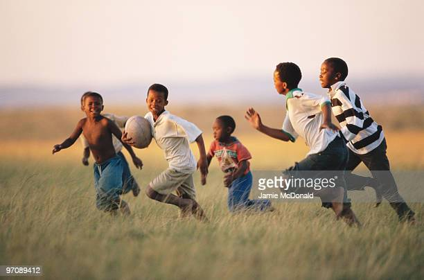 A group of children playing rugby on 21 June 1999 in East London South Africa