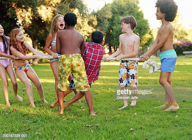 Group of children (8-10) playing tug of war
