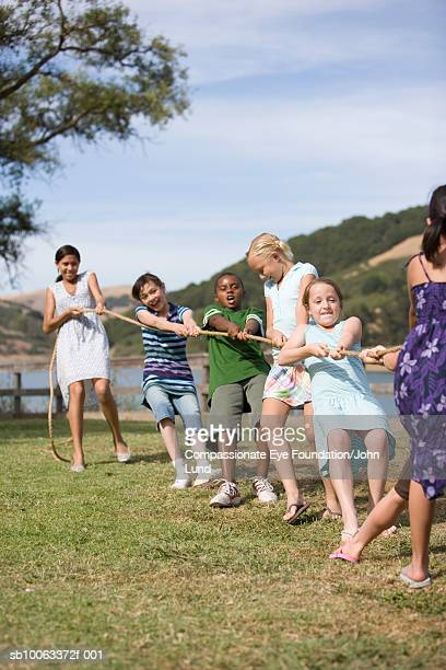 Group of children (9-13 years ) playing tug of war