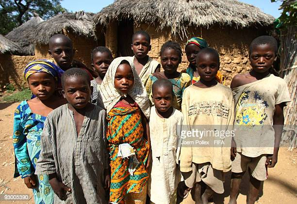 A group of children pose for the camera in the street on November 07 2009 in Bauchi Nigeria