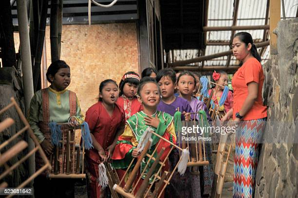 A group of children prepare to perform Angklung in Saung Udjo This Sundanese traditional instrument also play modern pop music to entertain visitor