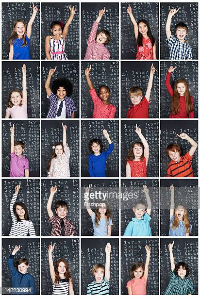 Group of children raising their arm in class