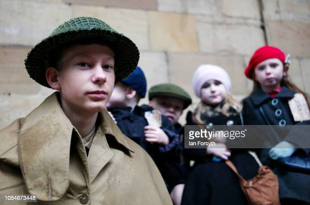 A group of children reenacting the journey of refugee children during the war pose for a picture at Pickering Railway Station during the North...
