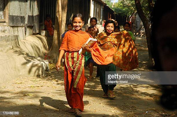 A group of children return home from school in Dhal Char They are climate refugees from Bhola district losing homes on the bank of the Meghna river...