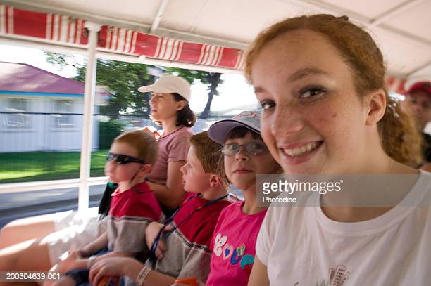 Group of children (6-7) (8-9) (10-11) riding in bus