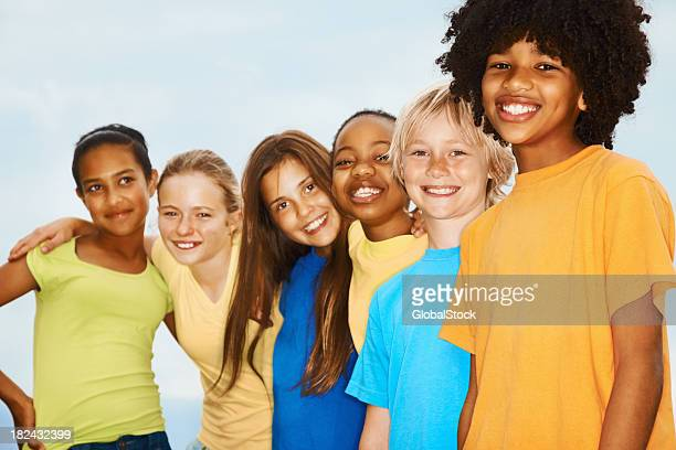 Group of children standing together and smiling