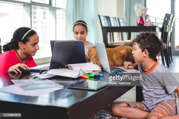 a group of children study at home - united arab emirates stock pictures, royalty-free photos & images