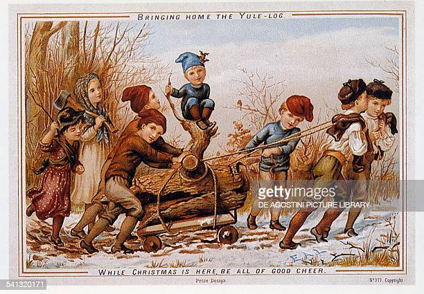 A group of children taking the Yule log home Christmas card United Kingdom late 19th century