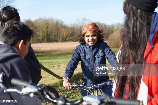 Group of children talking on cycle track