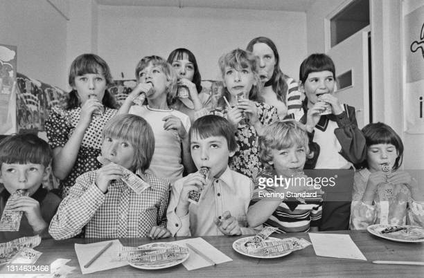 Group of children test a selection of fruit-flavoured Ice Pops, UK, 31st May 1974.