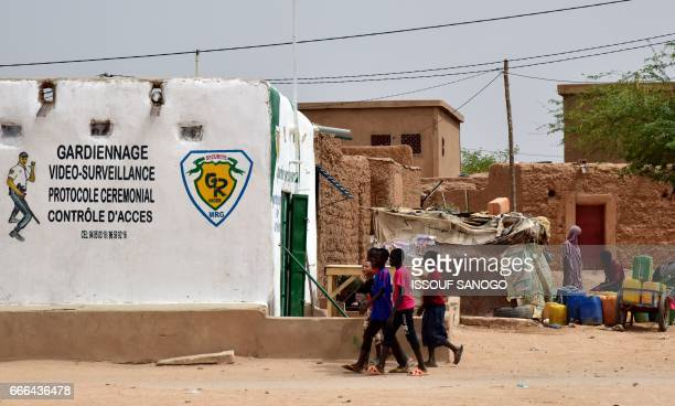 A group of children walk along a street in Agadez northern Niger on April 5 2017 Agadez the gateway to the desert a crossroads where thousands of...