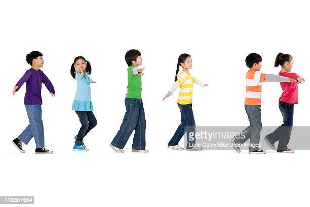 A group of children walking in a line