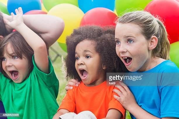 group of children watching something amazing - girl sitting on boys face stock photos and pictures