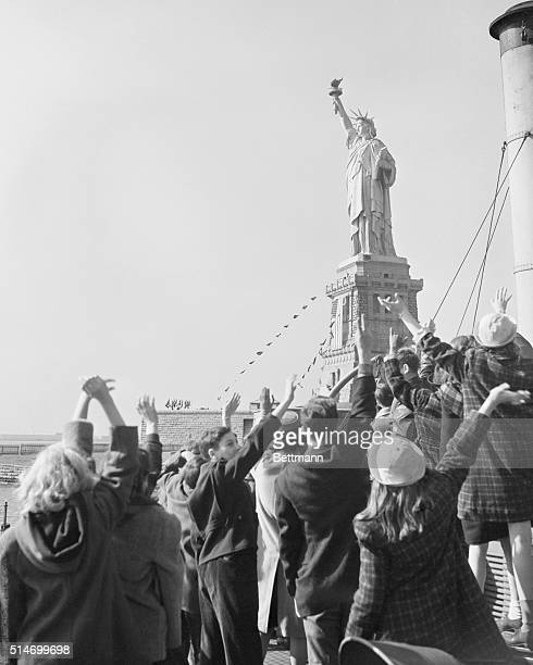 A group of children wave to the Statue of Liberty on its 56th birthday The ceremonies were sponsored by the American Committee for the Protection of...