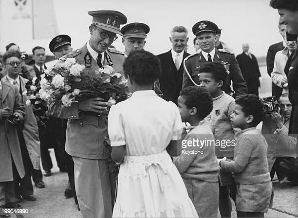 A group of children welcomes King Baudouin of Belgium on his arrival in Brussels after a visit to the Belgian Congo 13th June 1955