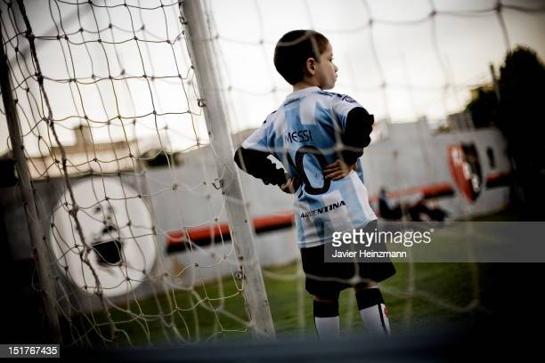 A group of children who wear Argentina and Newell´s Old Boys jerseys play at Malvinas Argentinas Sports Complex on April 27 2010 in Rosario Argentina...