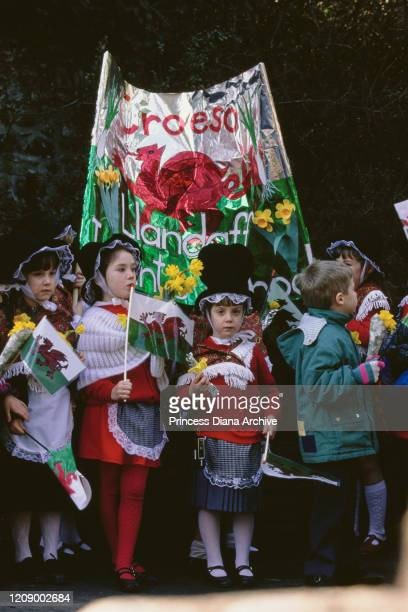 A group of children with a welcome sign in Llandaff in the north of Cardiff Wales during a visit by Prince Charles and Diana Princess of Wales for...
