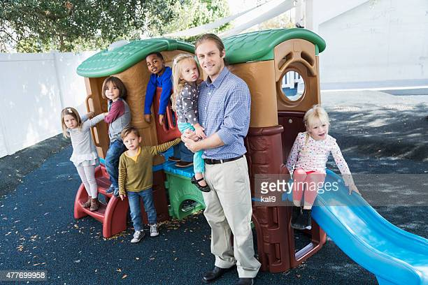 Group of children with adult at preschool playground