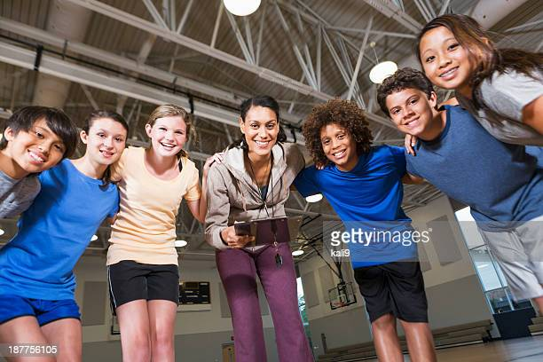 group of children with coach in school gym - physical education stock pictures, royalty-free photos & images