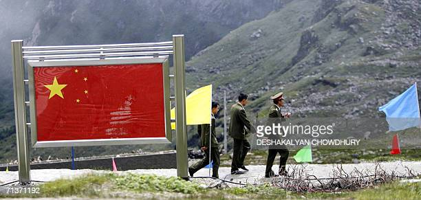 A group of Chinese army officers walk past a display board on the Chinese part of the IndoChinese border of Nathu La some 52 kilometres east of...