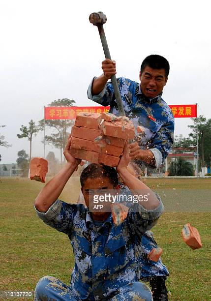 A group of Chinese elite exmarines show off their skills at their former base in Zhanjiang southern China's Guangdong province on April 23 2011 China...