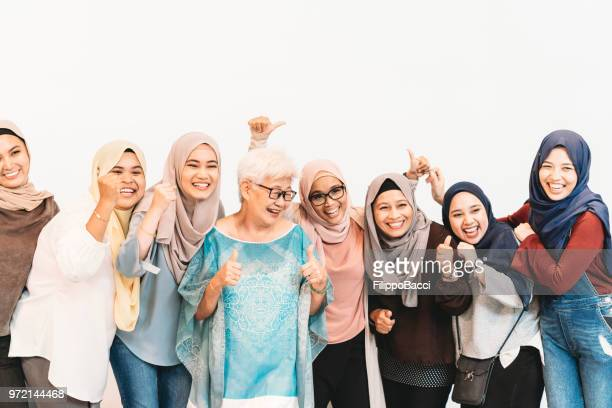 group of chinese, malaysian and indian women together - malay hijab stock photos and pictures