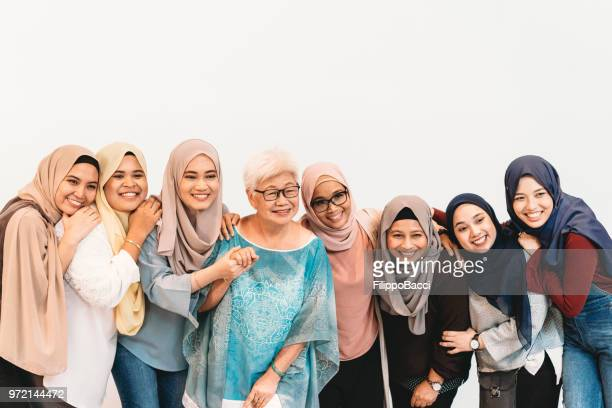 group of chinese, malaysian and indian women together - malaysia beautiful girl stock photos and pictures
