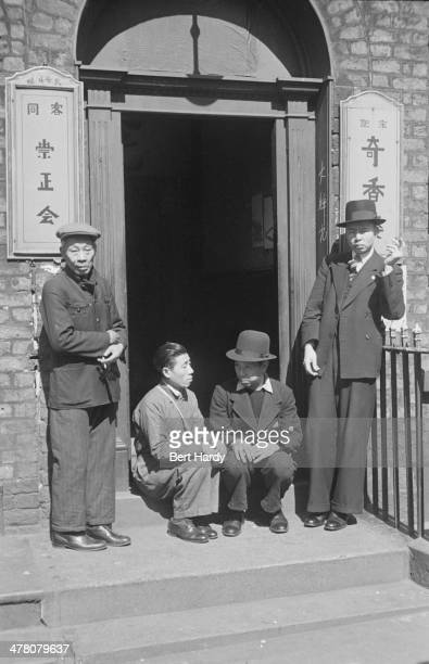 Group of Chinese seamen outside a Chinese hostel in Liverpool, May 1942. Original publication: Picture Post - 1136 - Chinese Hostel, Liverpool -...