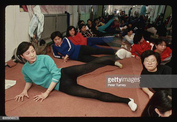 A group of Chinese woman participate in an aerobics class