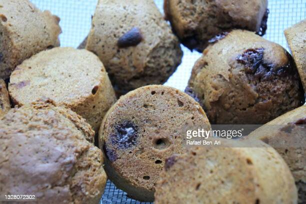 group of chocolate muffins in a baking tray - rafael ben ari stock pictures, royalty-free photos & images