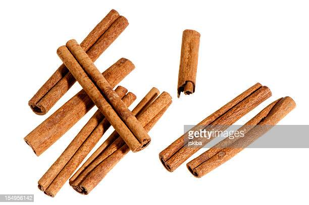 Group of cinnamon sticks on white background