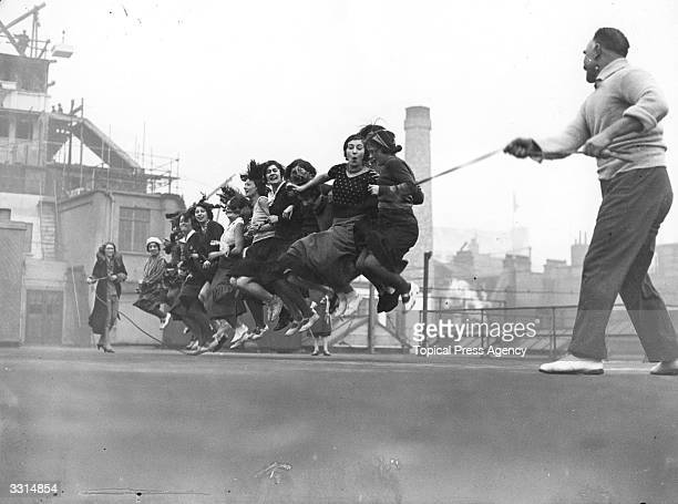 A group of clerks and typists seen here skipping on a Fleet Street roof
