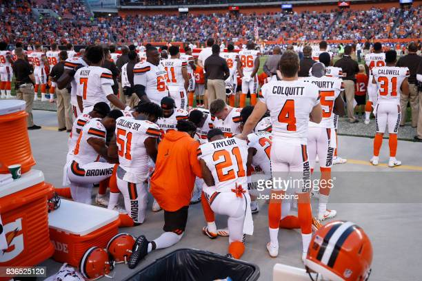 A group of Cleveland Browns players kneel in a circle in protest during the national anthem prior to a preseason game against the New York Giants at...