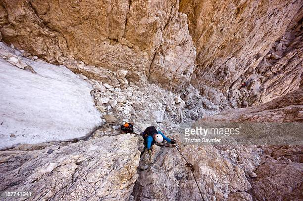 CONTENT] Group of climbers ascending the Santner Pass Via Ferrata in the Dolomites mountains Via Ferratas are climbing routes permanently equipped...